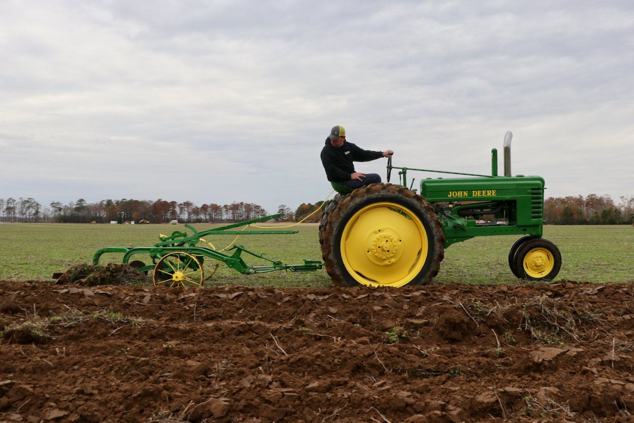 Antique tractors gather at Bonney Bright's Farm in Virginia Beach to turn rows of dirt during Plow Day